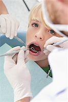 preteen open mouth - Dentist and Hygienist checking Boy's Teeth during Appointment, Germany Stock Photo - Premium Royalty-Freenull, Code: 600-06438917