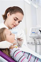 Dentist Checking Girl's Teeth during Appointment, Germany Stock Photo - Premium Royalty-Freenull, Code: 600-06438935