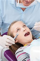 preteen open mouth - Dentist Checking Girl's Teeth at Appointment, Germany Stock Photo - Premium Royalty-Freenull, Code: 600-06438940