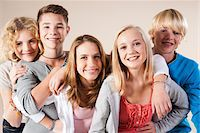 Portrait of Group of Teenage Boys and Girls Smiling at Camera, Studio Shot on White Background Stock Photo - Premium Royalty-Freenull, Code: 600-06438963