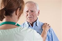 Senior Man being Examined by Medical Health Care Provider in Medical Office, Studio Shot on Beige Background Stock Photo - Premium Royalty-Freenull, Code: 600-06438981