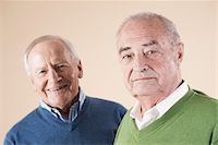 Portrait of Two Senior Men Looking at Camera, Studio Shot on Beige Background Stock Photo - Premium Royalty-Freenull, Code: 600-06438986