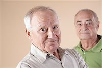 Portrait of Two Senior Men Looking at Camera, Studio Shot on Beige Background Stock Photo - Premium Royalty-Freenull, Code: 600-06438989