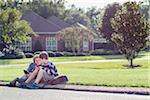 Two Boys Sitting on Neighbourhood Curb with Handheld Electronics Stock Photo - Premium Rights-Managed, Artist: Kevin Dodge, Code: 700-06439140