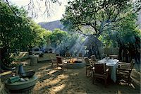 serengeti national park - Outdoor Dining Area at Lodge Serengeti, Tanzania, Africa Stock Photo - Premium Rights-Managednull, Code: 873-06440433