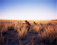 Bushmen Hunting in Grassy Field Namibia, Africa Stock Photo - Premium Rights-Managednull, Code: 873-06440473