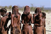 Rear-View of Himba Tribe Standing Outdoors Namibia, Africa Stock Photo - Premium Rights-Managednull, Code: 873-06440551