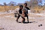 Bushman Children Playing with Toy Outdoors Namibia, Africa Stock Photo - Premium Rights-Managed, Artist: GreatStock, Code: 873-06440553