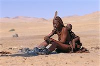 Himba Woman and Child Sitting Near Fire Namibia, Africa Stock Photo - Premium Rights-Managednull, Code: 873-06440558