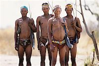 Portrait of Bushman Hunters with Bows, Arrows and Quivers Outdoors Namibia, Africa Stock Photo - Premium Rights-Managednull, Code: 873-06440561