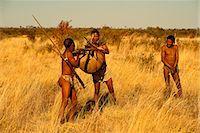Bushmen Carrying Their Kill Botswana, Africa Stock Photo - Premium Rights-Managednull, Code: 873-06440685