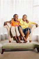 Children Sitting in Chair Stock Photo - Premium Rights-Managednull, Code: 873-06440809