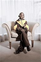 Boy Sitting in Chair Stock Photo - Premium Rights-Managednull, Code: 873-06440811