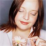 Woman Pulling Petals Off a Flower Stock Photo - Premium Rights-Managed, Artist: GreatStock, Code: 873-06440867