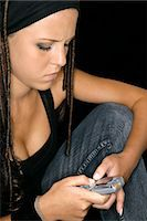 Teenager Using Cellular Phone Stock Photo - Premium Rights-Managednull, Code: 873-06441021