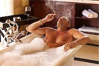 Man Smoking in Bathtub Stock Photo - Premium Rights-Managednull, Code: 873-06441031