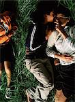 People Lying on Grass Stock Photo - Premium Rights-Managed, Artist: GreatStock, Code: 873-06441107