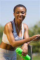 Female Jogger Resting by Fence Stock Photo - Premium Rights-Managednull, Code: 873-06441197