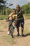 Father Helping Son Ride Bike Stock Photo - Premium Rights-Managed, Artist: GreatStock, Code: 873-06441213