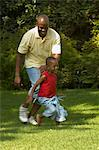 Father and Son Playing Outdoors Stock Photo - Premium Rights-Managed, Artist: GreatStock, Code: 873-06441221