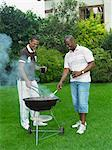 Men Barbecuing Stock Photo - Premium Rights-Managed, Artist: GreatStock, Code: 873-06441223