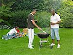 Men Barbecuing Stock Photo - Premium Rights-Managed, Artist: GreatStock, Code: 873-06441225