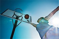 Young woman playing basketball Stock Photo - Premium Rights-Managednull, Code: 853-06441494