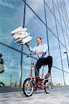 Man with pizza boxes on bike Stock Photo - Premium Rights-Managed, Artist: F1Online, Code: 853-06441563