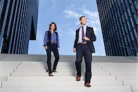 Businessman and businesswoman walking on stairs Stock Photo - Premium Rights-Managednull, Code: 853-06441702