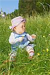 Female baby sitting in meadow with buttercups Stock Photo - Premium Rights-Managed, Artist: F1Online, Code: 853-06441920