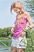 Blond young woman at a lake Stock Photo - Premium Rights-Managednull, Code: 853-06442055