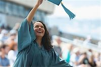 Happy female graduate Stock Photo - Premium Royalty-Freenull, Code: 614-06442274