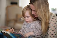 Mother and daughter reading book Stock Photo - Premium Royalty-Freenull, Code: 614-06442305