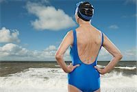 Senior woman wearing swimsuit looking towards sea Stock Photo - Premium Royalty-Freenull, Code: 614-06442311