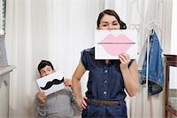 Couple holding lips and moustache Stock Photo - Premium Royalty-Freenull, Code: 614-06442388