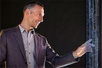 streaming - Businessman touching virtual information Stock Photo - Premium Royalty-Freenull, Code: 614-06442507