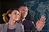 futuristic - Businesspeople touching world map Stock Photo - Premium Royalty-Freenull, Code: 614-06442511