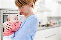 Mother holding newborn daughter Stock Photo - Premium Royalty-Freenull, Code: 614-06442546