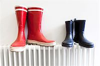 Wellington boots on radiator Stock Photo - Premium Royalty-Freenull, Code: 614-06442547