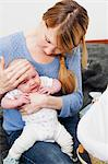 Mother holding unwell newborn daughter Stock Photo - Premium Royalty-Free, Artist: Cultura RM, Code: 614-06442565