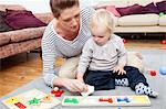 Mother and son playing with puzzle Stock Photo - Premium Royalty-Free, Artist: Arian Camilleri, Code: 614-06442577