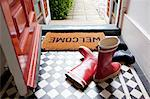 Welcome mat and wellington boots Stock Photo - Premium Royalty-Free, Artist: Blend Images, Code: 614-06442580