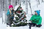 Couple decorating christmas tree Stock Photo - Premium Royalty-Free, Artist: CulturaRM, Code: 614-06442677