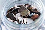 Cent coins in a jar Stock Photo - Premium Royalty-Free, Artist: Ikon Images, Code: 614-06442719