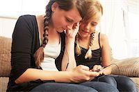 Two girls using smartphone Stock Photo - Premium Royalty-Freenull, Code: 614-06442814