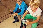 Two boys playing video game Stock Photo - Premium Royalty-Free, Artist: Westend61, Code: 614-06442817