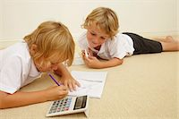 Two schoolboys doing homework Stock Photo - Premium Royalty-Freenull, Code: 614-06442826