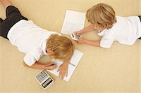 Two schoolboys doing homework Stock Photo - Premium Royalty-Freenull, Code: 614-06442827