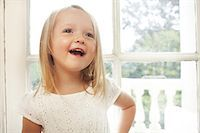 Happy little girl talking Stock Photo - Premium Royalty-Freenull, Code: 614-06442848
