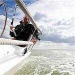 Man on yacht, with navigation aid Stock Photo - Premium Royalty-Free, Artist: CulturaRM, Code: 614-06442926